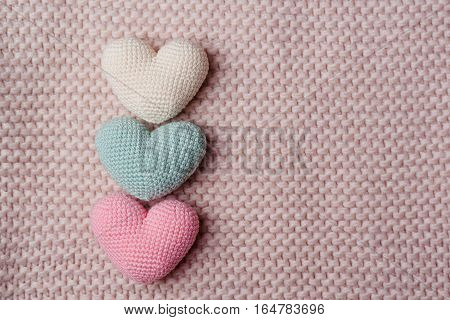 The knitted hearts . Background Valentines Day.Valentines day cards.