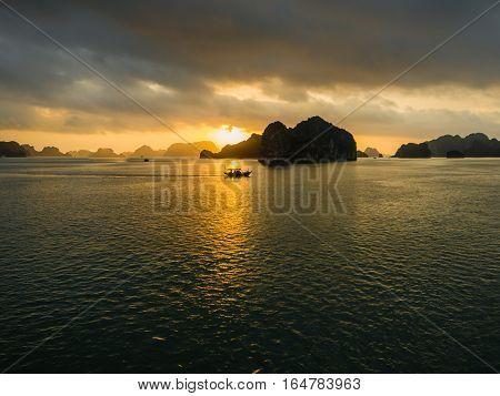 Ha Long Bay, Vietnam - December 02, 2015: Sunrise at Halong Bay, Vietnam. Unesco World Heritage Site. Most popular place in Vietnam
