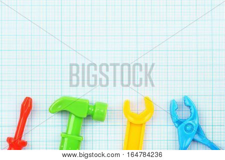 plastic tools on millimeter paper with copy space