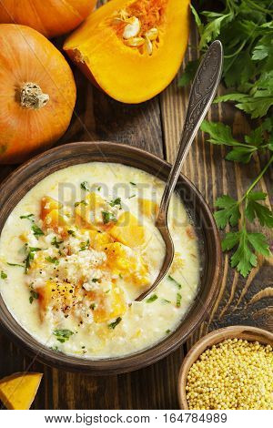 Cheese soup with pumpkin and millet in the ceramic plate