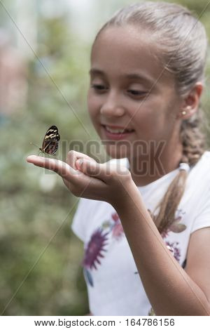 Happy Girl Holding A Butterfly