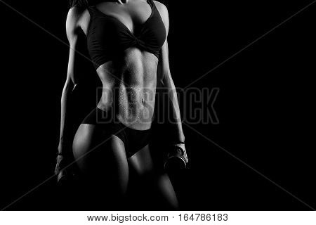 Blood, sweat and tears. Closeup monochrome shot of a stunning female athlete torso wet from training copyspace on the side