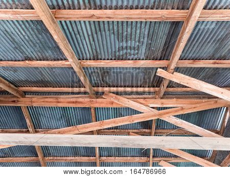 Wooden roof structure withe the zinc plate of the countryside house.
