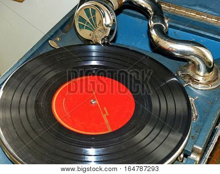 Old gramophone with a phonograph record. Closeup. Retro.