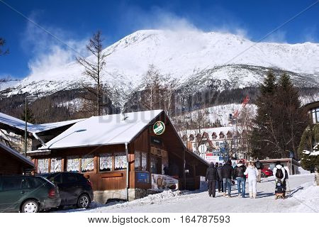 SLOVAKIA STARY SMOKOVEC - JANUARY 06 2015: View of the High Tatras mountains with the peaks covered with snow from center of Stary Smokovec. Is a popular resort in Slovakia for skiing and hiking.