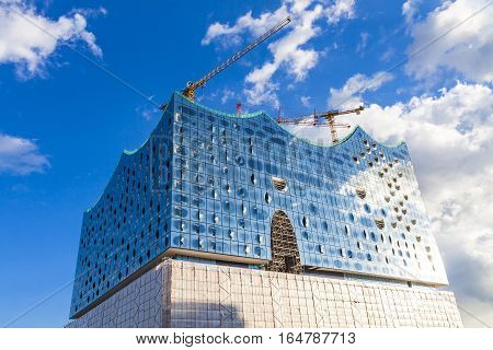 HAMBURG, GERMANY - JUNE 25, 2014: The Elbphilharmonie concert hall in the port of Hamburg. The tallest inhabited building of Hamburg with a height of 110 metres. Announced opening date is 11 Jan 2017