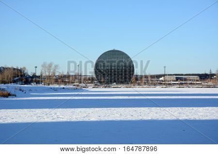 Pervouralsk City, Sverdlovsk region, Russia - 11.24.2016: Winter view to the Innovative Cultural Center Building from icy pond on 11.24.2016 in Pervouralsk City, Sverdlovsk region, Russia