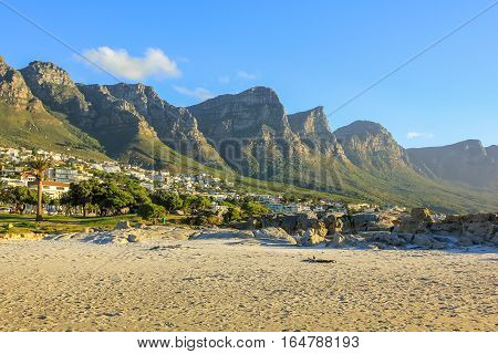 White long and spectacular beach of Camps Bay with Table Mountain National Park behind him in Cape Town, South Africa, Atlantic Ocean view.