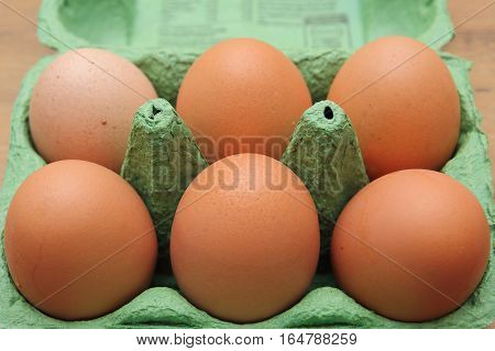 Brown Hen's Eggs In A Green Recyclable Carton Or Box, Shallow Depth Of Field