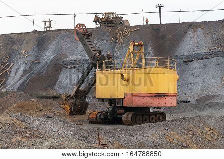 Old mine excavator. Excavator Bucket with rope drive, shovel.