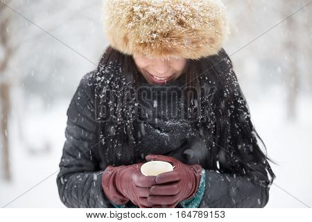 Elegant woman with furry hat, selective focus