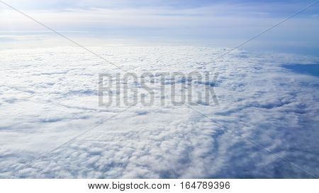 view the outer aircraft on the sky above the clouds in morning