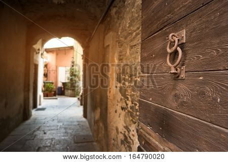 Old wood door. Stone tunnel and arch. Walk through historic district.