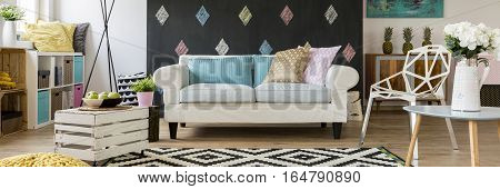 Pastel modern living room with a lot of decorative items