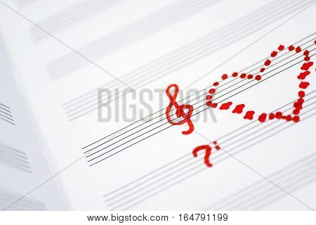 Valentine day abstraction on music sheet. Red symbols on white sheet.