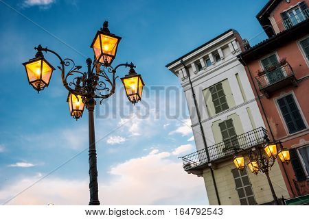 Street lamp on sky background. Classic town buildings. Morning in Stresa.