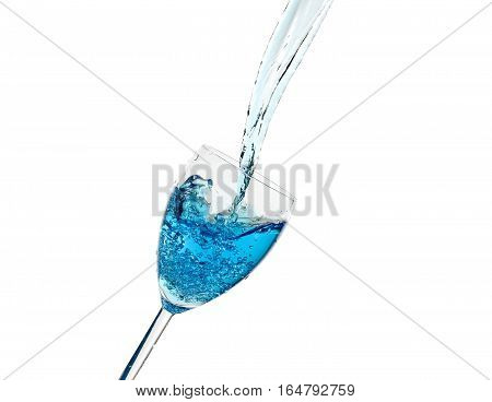 Creative splashing of blue water in the glass Isolated on white