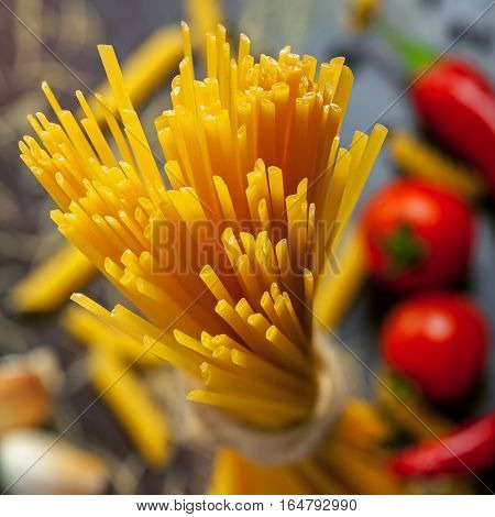 Raw spaghetti pasta close-up macro shot. Traditional Italian food.