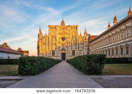 View of the cathedral of Certosa di Pavia Carthusian monastery at sunset.