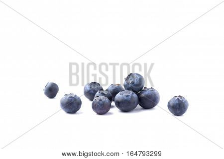 fresh blue blueberries isolated over white background