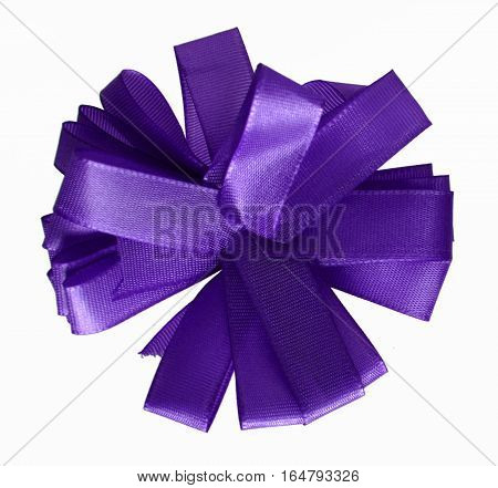 Purple ribbon bow in the shape of cornflower isolated on white background