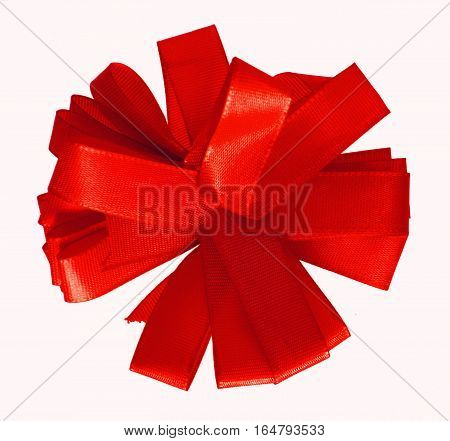 Red ribbon bow in the shape of cornflower isolated on white background