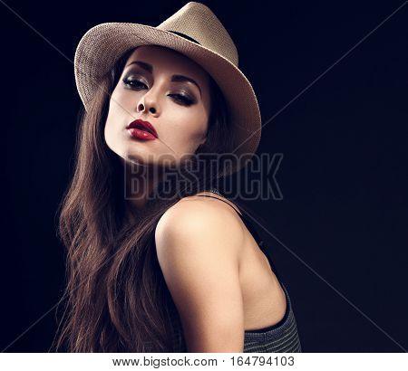 Beautiful Sexy Female Model In Cowboy Summer Hat And Hot Red Lips On Dark Background Posing. Closeup