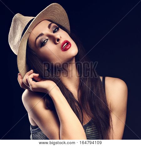 Sexy Female Model With Holding The Hand Cowboy Summer Hat And Posing In Fashion Top On Dark Backgrou