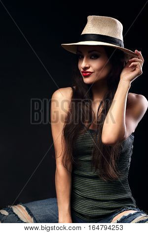 Beautiful Happy Grimacing Female Model With Long Brown Hair Posing In Cowboy Hat And Fashion Top And