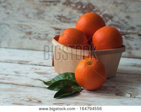 Fresh organic Orange. Oranges group freshly picked in a basket