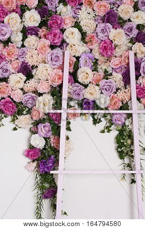 decorative staircase on the background of wall decorated with roses