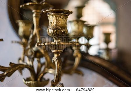 Part of gilded chandelier. Old chandelier indoors. Sell antiques at good price.