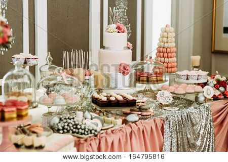 Beautiful Wedding Table With The Pink Desserts