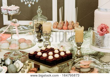 Sweet Assortie And Candles On The Wedding Table