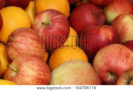 background of red apples and oranges in autumn
