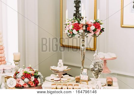 Beautiful Bouquets Of Flowers On The Table With Sweets