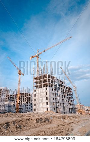 New residential development and big cranes/Construction area and powerful crane