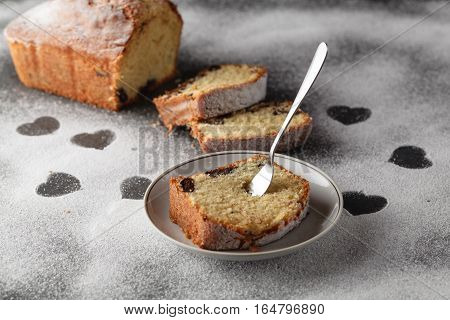 Piece of sliced cake on table with powder
