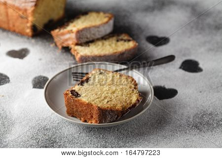 Piece of sliced cake on white table