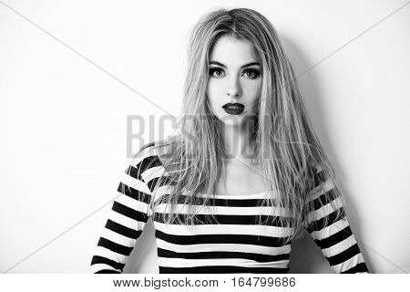 Street Style Hipster Girl Portrait on White Background. Not Isolated Black and White Photo with Shadow. Trendy Casual Fashion Outfit in Summer. Copy Space.