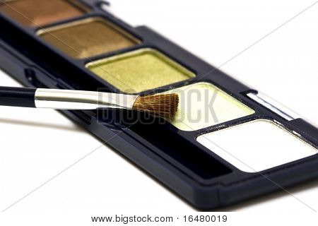 green make-up eyeshadows and cosmetic brush