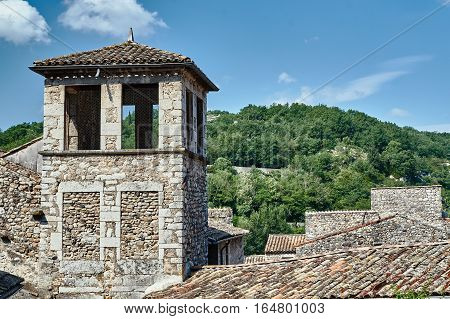Belfry medieval stone church in Vogue in France