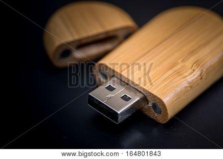 wooden usb flash isolated on black background