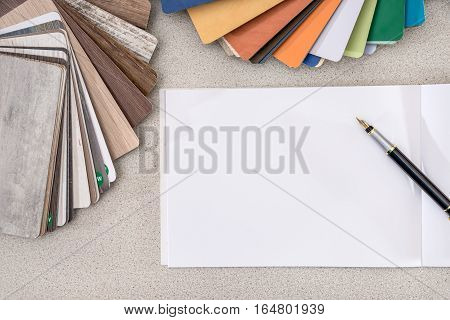 Wooden samples for furniture with blank note on desk