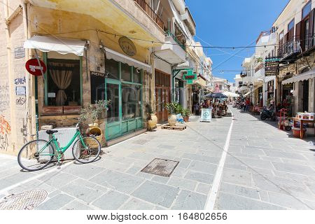Rethymnon, Island Crete, Greece- July 1 2016: The narrow street of Rethymnon (part of Old Town) where there are a lot of small cafes and shops