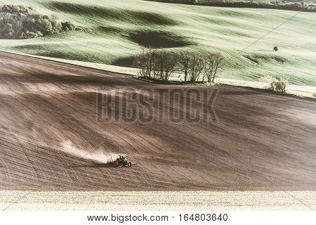 Vintage Tractor Handles Earth On Field