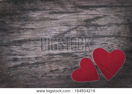 Old wooden background Red heart on the table.