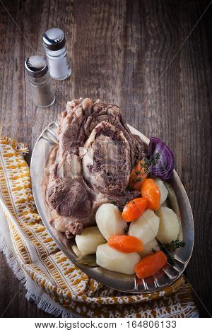 Pot-Au-Feu - French beef stew on a wooden surface