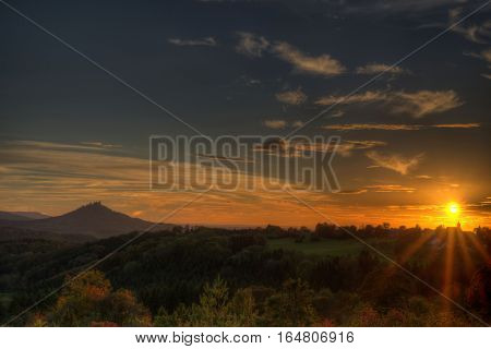 Sunset at the swabian alb with view to the castle Hohenzollern