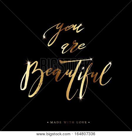 You are beautiful card. Hand drawn gold shiny lettering background. Ink illustration. Modern brush calligraphy. Isolated on black background. Compliment for women. Vector illustration stock vector.